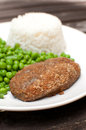 Breaded cutlet with rice and green salad Royalty Free Stock Photo