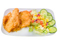 Breaded fish with green salad mango Royalty Free Stock Photos