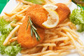Breaded fish steaks with french fries Stock Photo