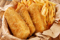 Breaded fish sticks and french fries Royalty Free Stock Photography