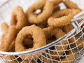 Breaded Onion Rings in a Basket Stock Images