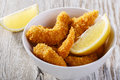 Breaded shrimp with lemon gold Stock Photo
