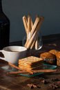 Breadsticks banana cake and biscuits with black coffee in the m morning on wooden table Royalty Free Stock Photos