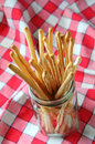 Breadsticks on Checkered Table Cloth Royalty Free Stock Images