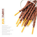 Breadsticks covered with chocolate on white background Stock Photography