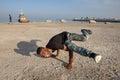 Break dance on the beach of Persian Gulf, southern Iran. Royalty Free Stock Photo
