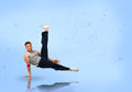 Break dancer balancing on one hand blue background Royalty Free Stock Photo