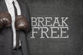 Break free on blackboard with businessman on side Royalty Free Stock Photo