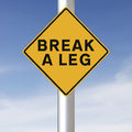 Break a leg road sign indicating Royalty Free Stock Photo