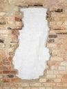 Break the old brick wall consisting of a variety of bricks. Royalty Free Stock Photo