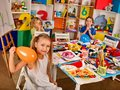 Break school in painting class. Small student paint on easel . Royalty Free Stock Photo