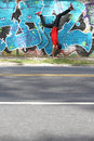 Breakdance a performing hiphop dancer in front of a graffiti wall Stock Image