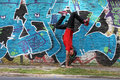 Breakdance a performing hiphop dancer in front of a graffiti wall Royalty Free Stock Photo
