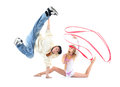 Breakdancer stands on hand and leg held up and gymnast Royalty Free Stock Photos