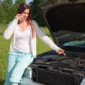 Breakdown on a car young woman showing with her finger at the engine because her has Stock Photo