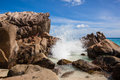 Breaker on the rocks granite at beach of la digue seychelles with a blue sky Stock Photo