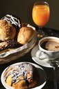 Breakfast arrangement in a warm morning light. Royalty Free Stock Photography