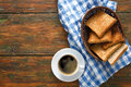 Breakfast background, toast and coffee on rustic wood, top view