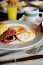 Breakfast with bacon fried egg orange juice and coffee Stock Photography