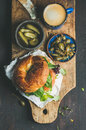 Breakfast with bagel, espresso coffee, capers and pickles Royalty Free Stock Photo