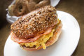 Breakfast bagel sandwich new york style with scrambled eggs and ham Royalty Free Stock Photography