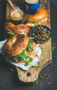 Breakfast with bagels, espresso coffee in glass and capers Royalty Free Stock Photo