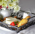 Breakfast in bed with bread cheese milk and fruits Stock Image