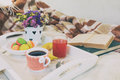 Breakfast in bed with hot coffee and macaroons. Royalty Free Stock Photo