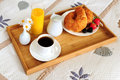 Breakfast on a bed in a hotel room Royalty Free Stock Image