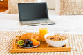 Breakfast in bed and a laptop Royalty Free Stock Photo