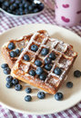 Breakfast with belgian waffles and fresh blueberry Royalty Free Stock Photo