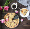 Breakfast berries cake with coffee and tulips Royalty Free Stock Photo