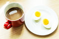 Breakfast boiled eggs with coffee is served on the table Royalty Free Stock Images