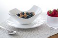 Breakfast of bran flakes blueberries Royalty Free Stock Images