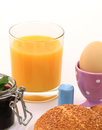 Breakfast bread egg with roll and eggs and orange juice Royalty Free Stock Images