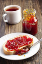 Breakfast with bread and jam cup of tea on old wooden table Stock Image