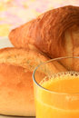 Breakfast bread orange juice with roll croissant and Royalty Free Stock Photo