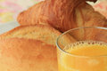 Breakfast bread orange juice with roll croissant and Stock Photography