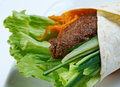 Breakfast burritos made with beef rissole and vegetables Stock Image