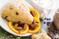 Breakfast cappuccino with fresh cranberry orange scone for Royalty Free Stock Photos