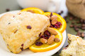 Breakfast cappuccino with fresh cranberry orange scone for Stock Photography