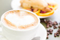 Breakfast cappuccino with fresh cranberry orange scone for Royalty Free Stock Photo