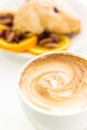 Breakfast cappuccino with fresh cranberry orange scone for Royalty Free Stock Image