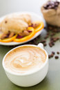 Breakfast cappuccino with fresh cranberry orange scone for Stock Image