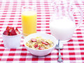 Breakfast of cereal, fruit, orange juice and milk Royalty Free Stock Images