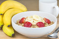 Breakfast cereal oat flakes and fruit for Stock Photography