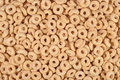 Breakfast cereal rings background as texture Stock Photo