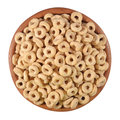 Breakfast cereal rings in a wooden bowl on a white background Stock Photography