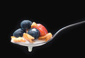Breakfast cereal spoon with milk and berries Stock Image