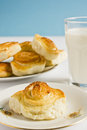 Breakfast with cinnamon buns and glass of milk on a blue background. Royalty Free Stock Photo